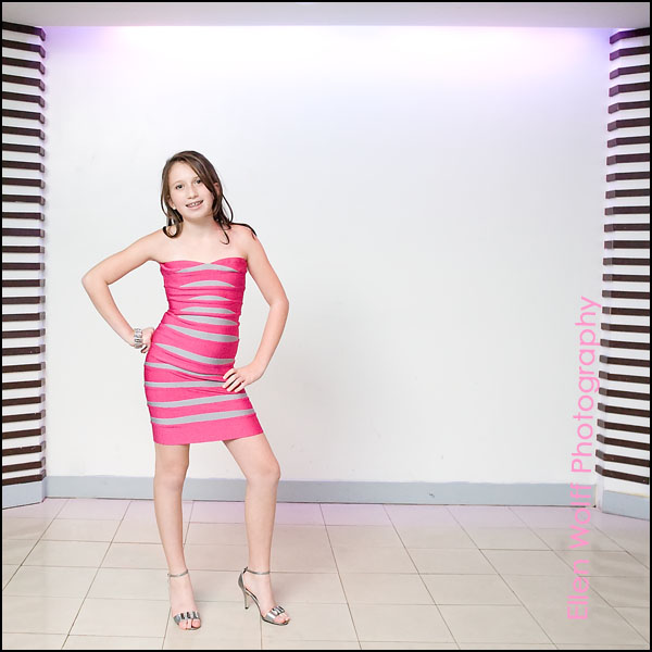 bat mitzvah party photo wearing a pink and silver bandage dress