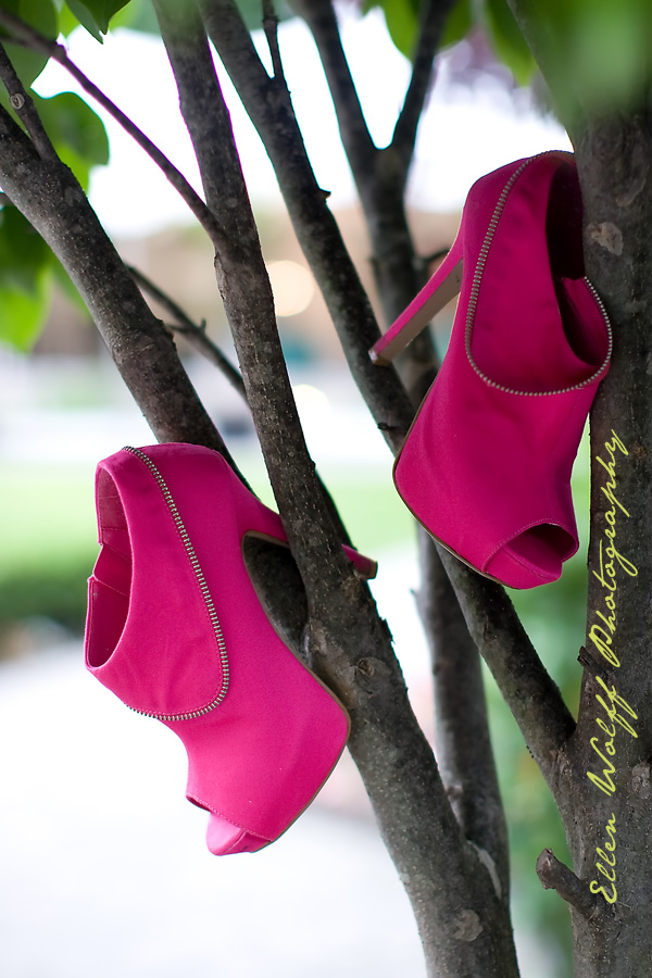 fun photo of a pair of sweet 16 party platform shoes in fuschia